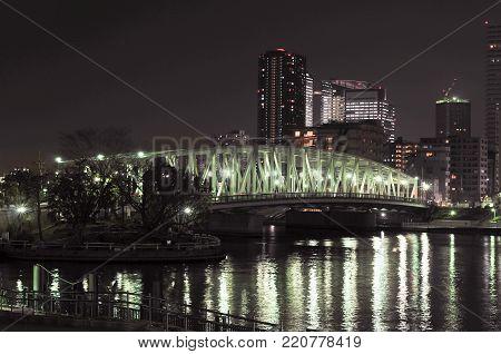 Eitai-bashi Bridge near the Monzen-nakacho area crossing the Sumida River in Tokyo, Japan at night.