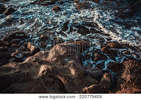 View of ocean waves and fantastic rocky coast