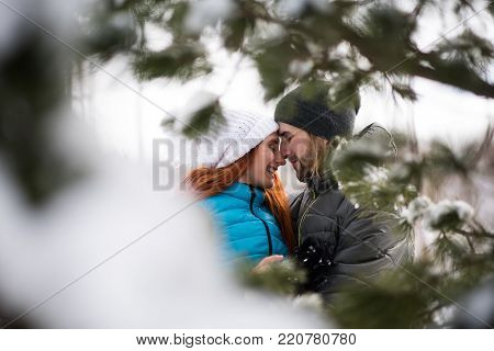 Loving affectionate couple facing each other in snow
