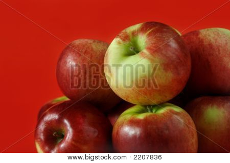 some fresh Cortland apple on red background poster