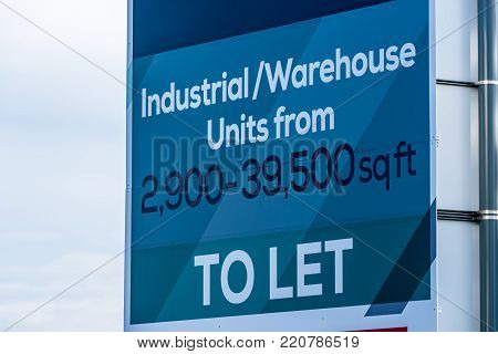 Estate agents industrial warehouse unit unit to let sign.