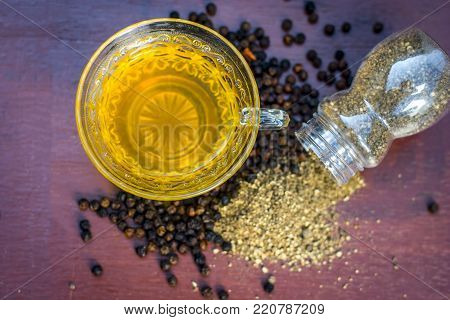 Close Up Of Tea Of Black Pepper,piper Nigrum With Raw Black Pepper And Powder.