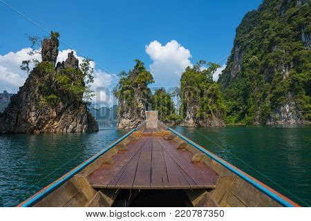 Longtail boat trip in Cheow Lan Lake Surat Thani Province, Thailand.