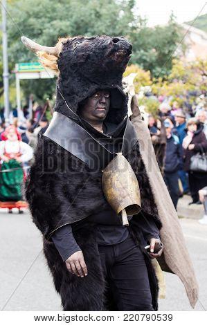 MURAVERA, ITALY - APRIL 2, 2017: 45th Citrus Festival - Ethnic Masks Bois and Fui Janna Morti di Escalaplano - Sardinia