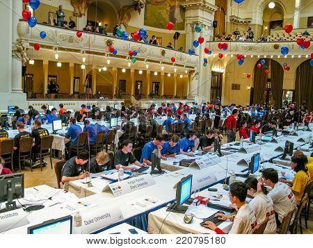 PRAGUE, CZECH REPUBLIC - MARCH 31, 2004: Students solve tasks at International Collegiate Programming Contest in Obecni Dum concert hall in Prague, Czech Republic on March 31, 2004.