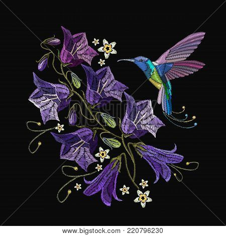 Embroidery violet flowers bells and humming bird. Beautiful violet cornflowers and humming bird, classical art embroidery. Fashionable template for design of clothes