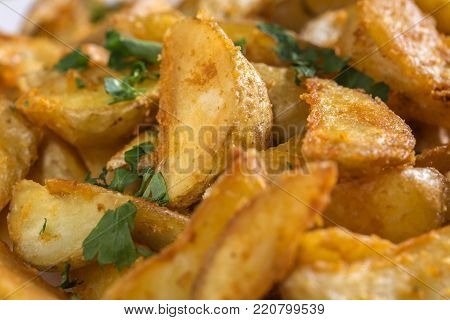 Close up of potato wedges with a spicy Mexican coating and par