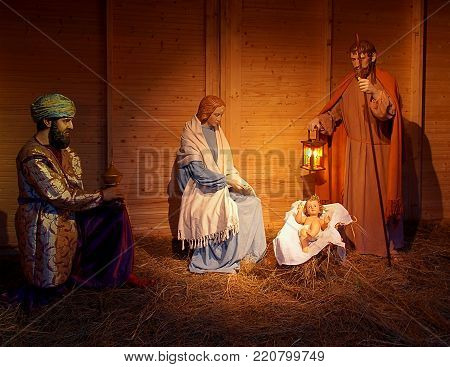 Royal worship. Lodz, Poland - December 26, 2017 The mythical king Belshazzar bows to the born Jesus and a gift in the form of myrrh, a Christmas crib scene built at the archcathedral basilica in Lodz.