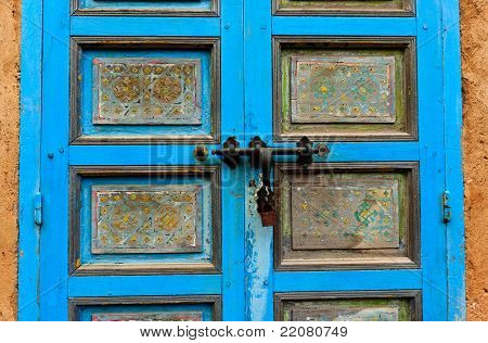 Close Up Of Blue Door And Deadbolt Lock
