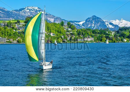 Lucerne, Switzerland - April 2017: Boat at Lucerne lake with Swiss Alps at the background