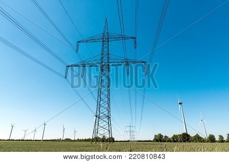 Electric pylons and  a power transmission line seen in Germany