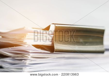 Stack of Paper documents with clip, Pile of unfinished documents on office desk folders. Business papers for Annual Report files, Document is written,presented. Business offices concept.