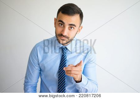 Closeup portrait of serious office worker showing warning gesture with raising finger. Leader admonishing his team of making typical mistakes. Business and mentoring concept
