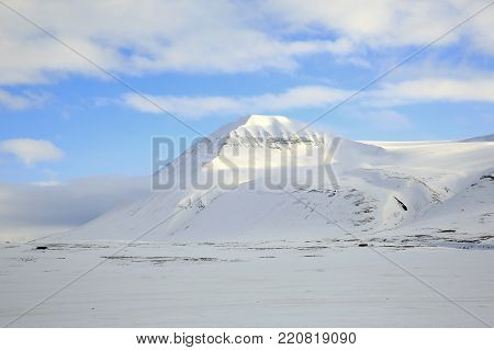 Snow-covered Mountain Landscape at Spitsbergen. Svalbard, Norway