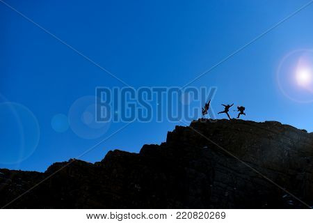 fun, cheerful, happy and energetic mountaineers & jumping
