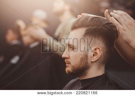 Barbershop. Man with beard in barber shop. Modern hair salon