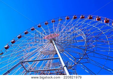 Minsk ferris wheel in central city park, Belarus. Ferris wheel against a blue sky.