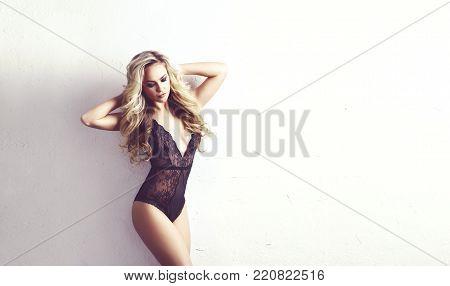 Sexy woman posing in beautiful lingerie. Fashion model in erotic underwear.