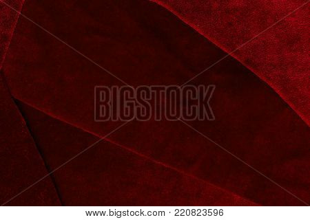 Beautiful luxury dark red patchwork velvet texture background cloth. flaps of velvet fabric with a reflection