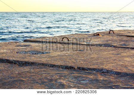Pier of large concrete blocks on the sea