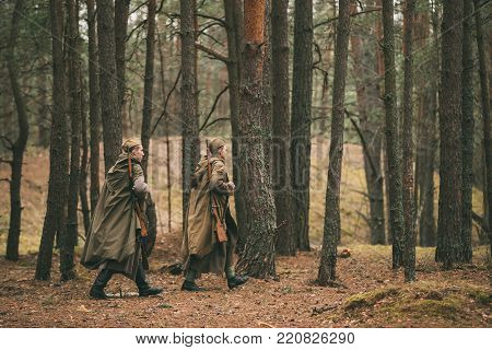 Gomel, Belarus - April 22, 2017: Two Re-enactors Dressed As Soviet Russian Red Army Infantry Soldiers Of World War II Marching Along Forest At Autumn Day