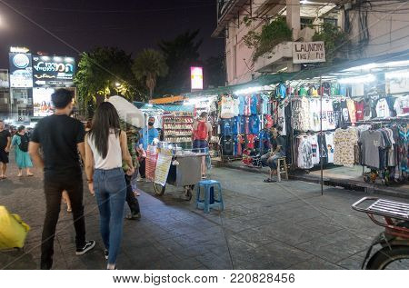 BANGKOK, THAILAND - December 23 2017: Backpackers and Tourists walk on Khao San Road in Bangkok, Thailand. Khao San Road is a famous low budget hotels and guesthouses area in Bangkok.