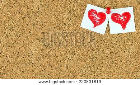 Valentines day background. There are two red brushed hearts on white pieces of paper pinned on the upper right corner conner of cork brown board for notes, empty place for text on the center. The red button has used.