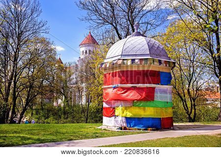 Colorfully decorated building at the Art Incubator in Uzupis, Vilnius.Lithuania. The towers of the Orthodox Cathedral are seen behind it. Summer.