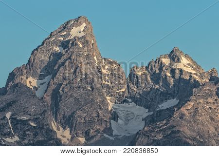 the scenic teton mountain peaks in Wyoming at sunrise