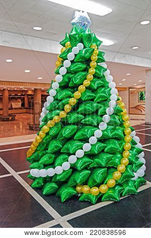 Creative Christmas tree made of inflatable balloons of green color in the foyer of Opera House