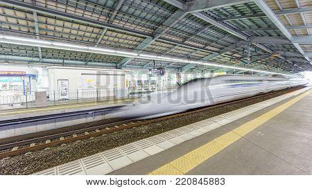 KOBE, JAPAN - JUNE 05, 2015: A Shinkansen Bullet Train in Kobe station, Japan. The Shinkansen is the world's busiest high-speed rail line.