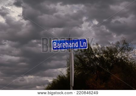 A cloudy day for a strangely named road in Arizona called Barehand Lane.