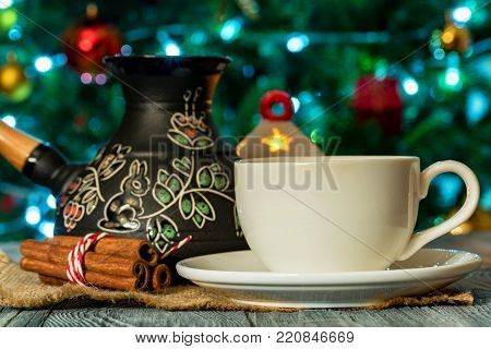 Cup of Turkish coffee in homely winter and Christmas settings. Coffee beans and cezva. Warm and hearthrug, Danish hygge concept. Snug still life. Selective focus