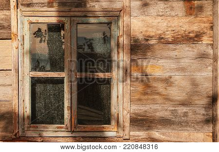 Details of the old wooden window and wall, exterior part of an old house.