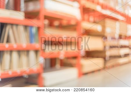 Blurred Lumber Construction Shelves At Home Improvement Store