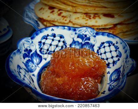 Apple jam for russian blinov in the vase Gzhel.Maslenitsa is an Eastern Slavic traditional holiday.Gzhel-Russian folk craft of ceramics and production porcelain and a kind of Russian folk painting.