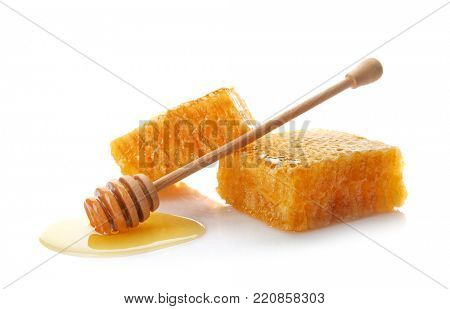 Fresh honeycombs with dipper on white background