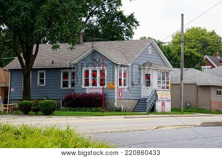 JOLIET, ILLINOIS / UNITED STATES - JULY 25, 2017: A psychic offers tarot card readings and fortune telling services, in a home on Ruby Street.