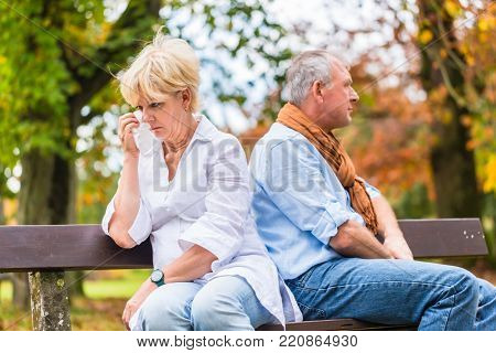Senior man and woman having argument having marital fight, being frustrated about the conflict