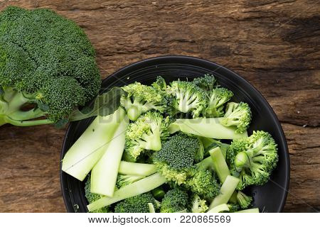 Healthy Green Organic Raw Broccoli Florets Ready For Cooking. Raw Fresh Broccoli On Wooden Table