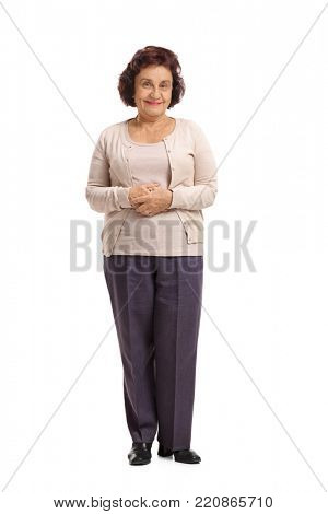 Full length portrait of an elderly woman looking at the camera and smiling isolated on white background