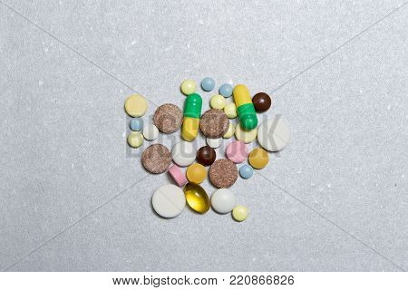 Opioid Pills. Colored pills on a silver background.The concept of Opioid epidemic .