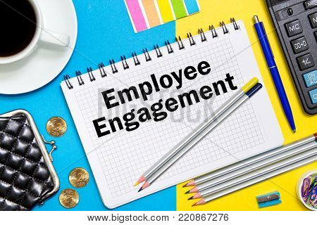 Employee Engagement notes in the notebook on the Desk of a businessman in office. Business concept Employee Engagement.