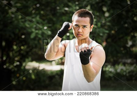 Asian young men thai boxing hand wraps for boxing, Boxing gloves