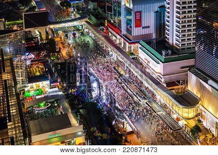BANGKOK, THAILAND - DECEMBER 31, 2017: Crowds prepare to Party Countdown in front of Central World, the biggest shopping mall on Ratchadamri road, Bangkok, Thailand