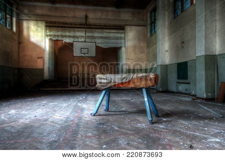 Abandoned Sports Hall With A Pommel Horse Apparatus In An Abandoned School