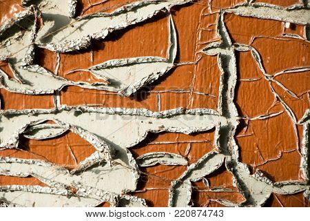 Old and peeled creaky paint , In course of time the paint of white tone peeled off the old planks and crackled, wood texture, background, colorful, cracks in the paint, vintage, abstract, grunge