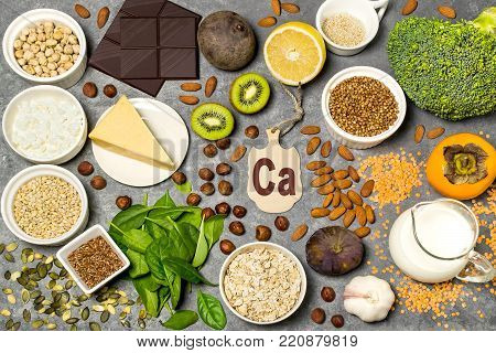 Food is source of calcium. Various natural food rich in vitamins and micronutrients. Useful food for health and balanced diet. Prevention of avitaminosis. Small cutting board with name of calcium