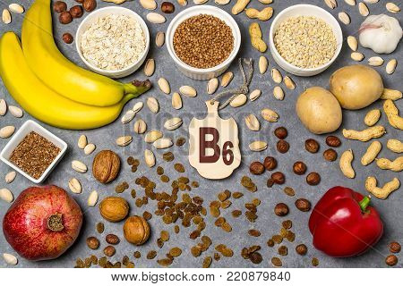 Food is source of vitamin B6. Various natural food rich in vitamins. Useful food for health and balanced diet. Prevention of avitaminosis. Small cutting board with name of vitamin B6. Top view