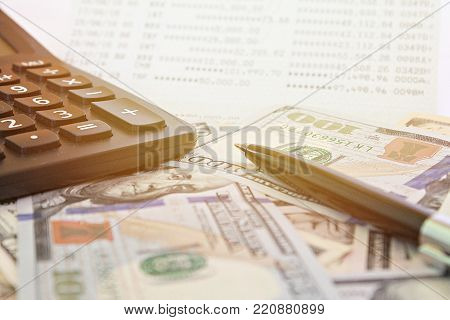 Business, finance, investment, accounting or money exchange concept : American Dollars cash money, calculator on savings account passbook or financial statement poster